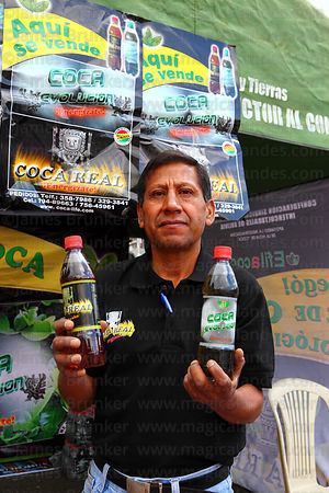 Man showing samples at a stall selling fizzy soft drinks at trade fair promoting alternative products made from coca leaves , La Paz , Bolivia