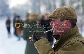 Huntsman John Holliday blows for hounds - The Belvoir Hunt on foot in Stathern 22/1/13