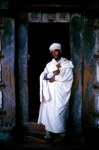 Ethiopia - Lalibela - A Ethiopian priest at the cave monestery of Yimrehane Kristos