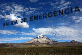 Emergency exit sign on bus window, Sajama volcano in background