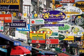 Brightly coloured signs at Khao san road Thailand