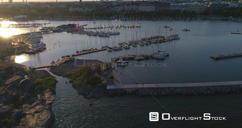 Harbour at sunset, aerial view merisatama and liuskasaari harbour, on a sunny summer evening dusk, in Helsinki, Uusimaa, Finland