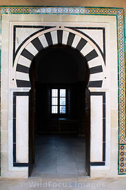 Archway leading to a prayer hall of the Mosque of the Barber. Kairouan, Tunisia; Portrait