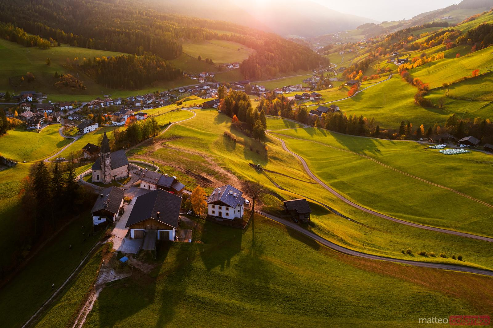 Aerial drone view of Santa Maddalena town at sunset