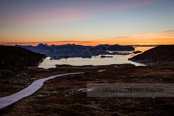 The boardwalk of the hiking trail in Ilulissat leading to the icebergs of the Icefjord, a Unesco World Heritage site