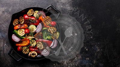 Grilled assorted vegetables in cast iron pan on dark background copy space