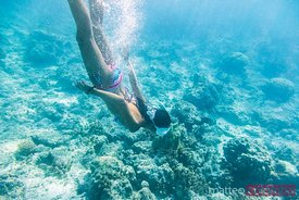 Tourist underwater in the blue lagoon, Tikehau, French Polynesia
