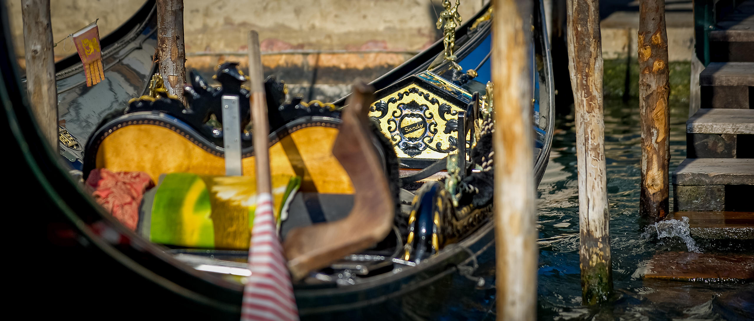 Close-up of a Gondola Moored on the Grand Canal with Oar and Details