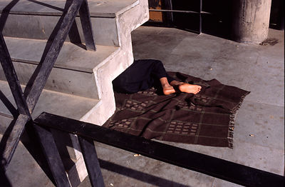 India - Chandigarh - A man sleeps under some stairs