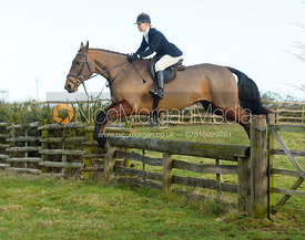 Marina Bealby jumping a hunt jump at Hill Top Farm