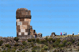 "Tourists visiting the ""lizard chulpa"", a cut stone Inca period chulpa / burial tower, Sillustani, Peru"