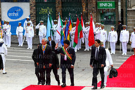 Bolivian president Evo Morales Ayma (centre) and vice president Alvaro Garcia Linera (left) arrive for official events for Dia del Mar / Day of the Sea, Plaza Avaroa, La Paz, Bolivia