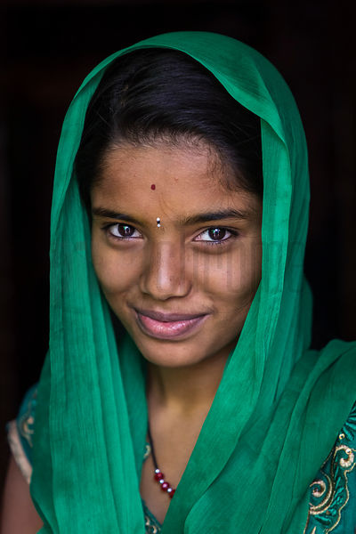 Portrait of a Young Woman Wearing a Green Sari