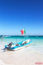 Motor boat with mexican flag on the shore, Mexico