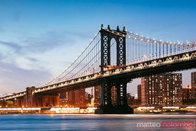 Manhattan bridge illuminated at dusk, New York city