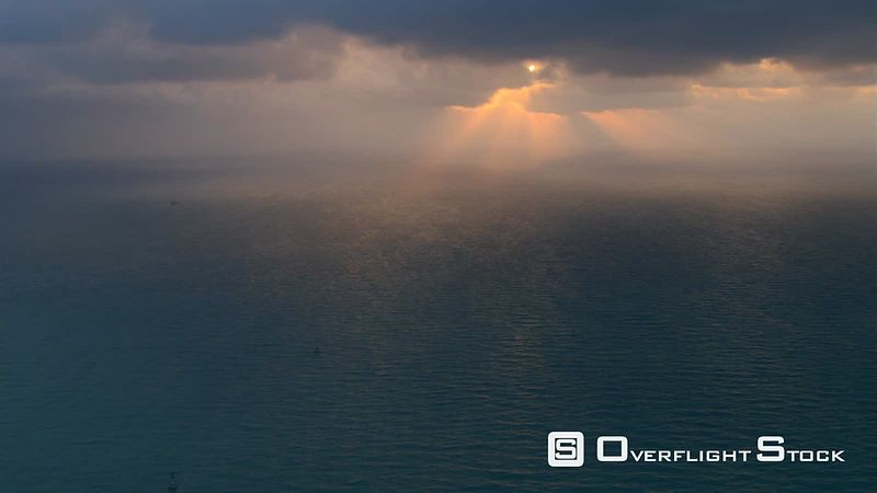 Sunset flight over Atlantic waters off the Florida coast