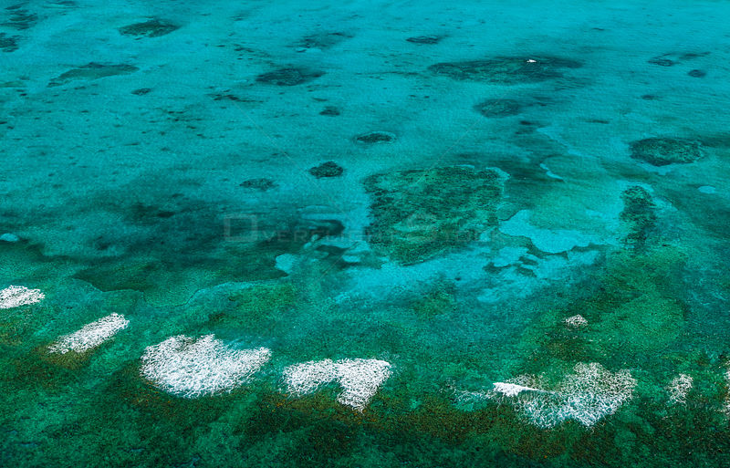 Aerial view of coastline, coral reefs and sandbanks of island of the Bahamas archipelago, Caribbean, February 2012