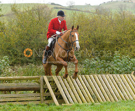 Andrew Osborne jumping the hunt jump at Peakes Covert