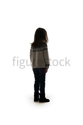 A Figurestock image of a little girl in a winter jumper, standing, facing away – shot from low level.