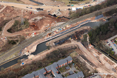 aerial photograph showing construction of the new Railway Bridge and canal aqueduct over the Sell Oak Bypass / A38 / Aston Webb Boulevard in Birmingham England UK