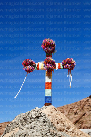Cross decorated with wool at Puritama, Region II, Chile