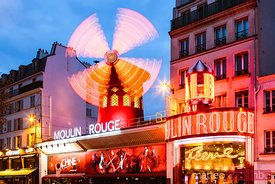 Famous Moulin Rouge at night, Montmartre Paris, France