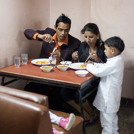 A family eat lunch in the Indian Coffee House, Chandigarh