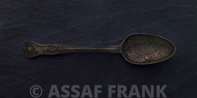 Antique silver spoon on dark background