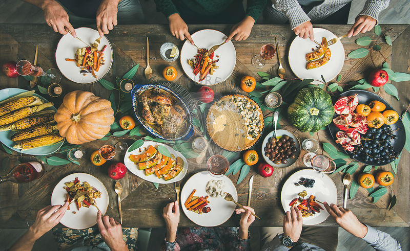 Friends or family eating nacks at Christmas table, horizontal composition