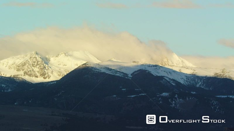 The early morning sunrise highlights the snow-covered peaks of the Tobacco Root mountains near Ennis, Montana