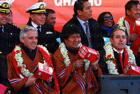 Bolivian president Evo Morales (centre) and vice president Alvaro Garcia Linera left) hold rattles in the form of cable car cabins during the Red Line  inauguration ceremony , La Paz, Bolivia