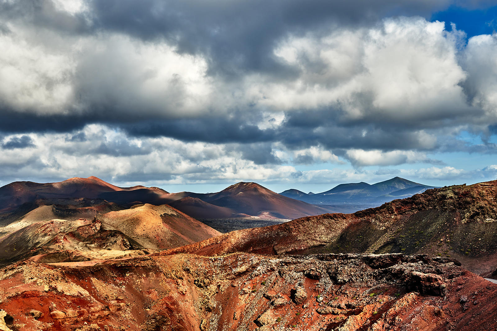Volcanoes under the clouds in Timanfaya national park, Lanzarote
