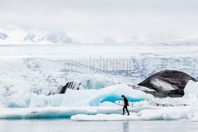 Surfer alking on Calved Ice