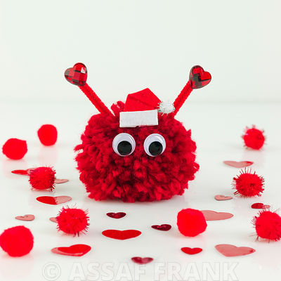 Christmas pom pom on white background