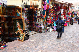 Souvenir shops in historic street, Cusco, Peru