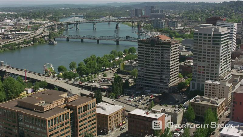 Portland, Oregon Daytime aerial shot of downtown Portland, Oregon buildings and bridges.  Shot with Cineflex and RED EpicW Helium.