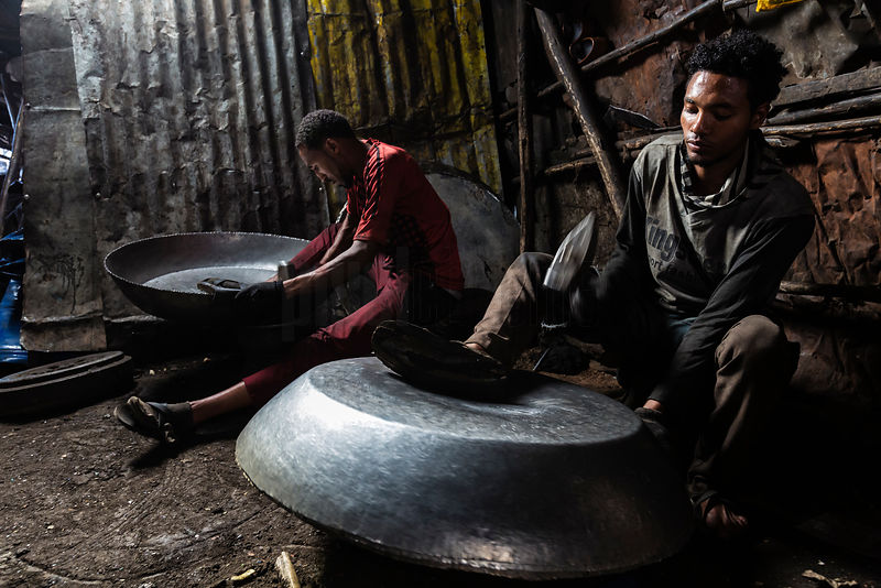 Metal Workers Pounding 55 Gal Drums into Cooking Pots