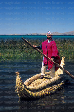 Well known reed boat builder Paulino Esteban on totora reed boat, Lake Titicaca, Bolivia