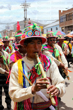 Musician from Lampa village playing pinkillo flute, Virgen de la Candelaria festival, Puno, Peru