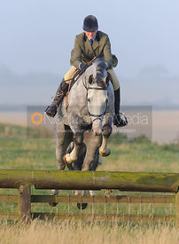 Jumping a hunt jump with the Cottesmore