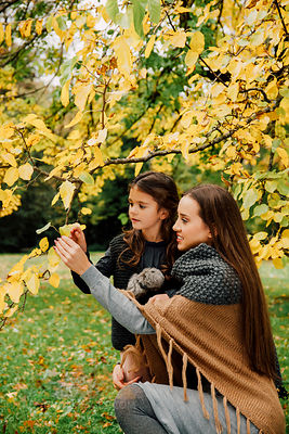 Young woman and little girl in autumn