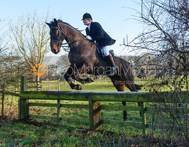 jumping a hunt jump away from the meet - The Cottesmore Hunt at Pickwell Manor 28/12