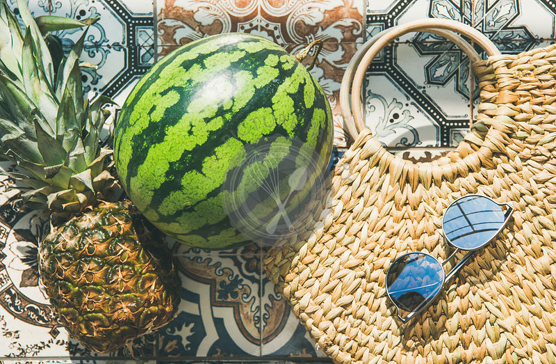 Summer lifestyle background with fruits and straw bag