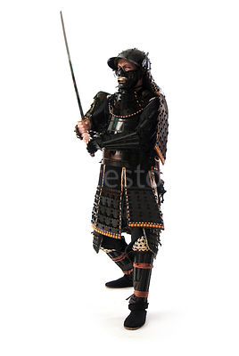A silouette of a western Samurai warrior with his sword in the air - shot from mid-level.