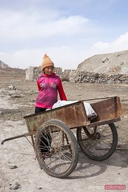 Kirgiz young girl near a chariot, Karakul lake, China