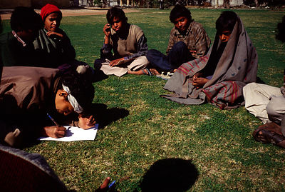 India - Delhi - Child laboure at a literacy class
