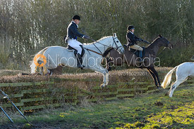 Hilary Butler jumping a hedge at Town Park Farm - The Cottesmore at Town Park Farm