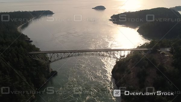 One driver on Deception Pass bridge in Washington State cruising along at golden hour in San Juan Islands