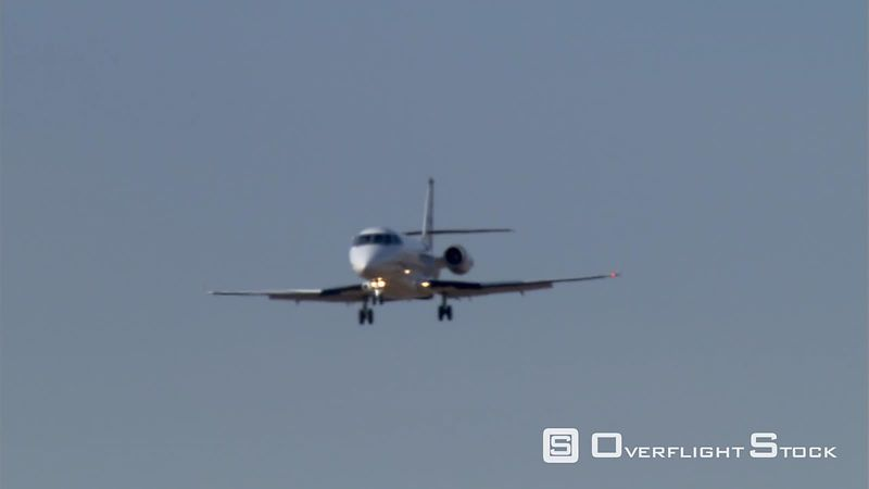 Business jet descending, close shot