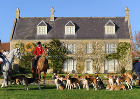Belvoir Huntsman John Holliday and the Belvoir foxhounds in front of Hall Farm.